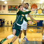 Amherst's Antonio Serrano shoots past Clearview's Jason Young. LINDA MURPHY/CHRONICLE