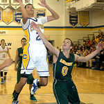 Clearview's Daimaon Knowles shoots past Amherst's Adam Srnis. LINDA MURPHY/CHRONICLE
