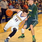Clearview's Eric Burkey works around Amherst's Antonio Serrano. LINDA MURPHY/CHRONICLE