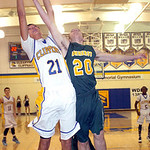 Clearview's Kaimon Knowles fights Amherst's Garrett Klekota for the rebound. LINDA MURPHY/CHRONICLE