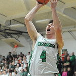 Columbia's Jay Banyasz hits a shot in the first half of the sectional final. STEVE MANHEIM/CHRONICLE