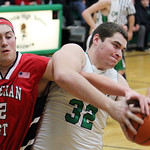 ANNA NORRIS/CHRONICLE Columbia's Brandon Heidecker tears the rebound away from Lutheran West's Max Quinn in the first half Friday night at Columbia High School.