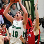 ANNA NORRIS/CHRONICLE Columbia's David Delahunty goes up for a basket against Lutheran West's Nate Roman in the second half Friday night at Columbia High School.