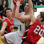 ANNA NORRIS/CHRONICLE Columbia's Jay Banyasz muscles up for the basket drawing a foul on Lutheran West's Aaron Beckman in the first half Friday night at Columbia High School.