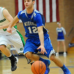 Midview's Matt Randolph pushes the ball up court. JUDD SMERGLIA/CHRONICLE