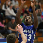 Midview's Daimion Mahone pulls up for a long jump shot over Columbia's Jay Banyasz.  ANNA NORRIS/CHRONICLE