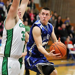 Midview's Grant Overy muscles up for a layup against Columbia's Brandon Heidecker.  ANNA NORRIS/CHRONICLE