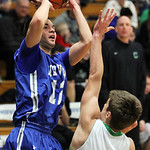 Midview's Matt Randolph pulls up a short jump shot over Columbia's Michael Boey.  ANNA NORRIS/CHRONICLE