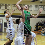 Columbia's David Delahunty shoots over Vermilion's Kyle Nader, center, and Aaron Dawson. STEVE MANHEIM/CHRONICLE