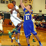 Clearview's Daimon Knowles blocks Elyria Catholic's DJ Graham's shot. LINDA MURPHY/CHRONICLE