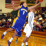 Clearview's Gerrell Williams fights Elyria Catholic's Ceeven Shelton for the rebound. LINDA MURPHY/CHRONICLE