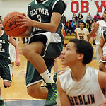 Elyria Catholic's Angelo Cruz drives to the basket. STEVE MANHEIM/CHRONICLE