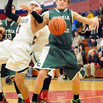 Elyria Catholic's Conner Riddell and Oberlin's Marvin Jackson fight for the rebound. STEVE MANHEIM/CHRONICLE