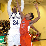 Lorain's Rashod Berry shoots past Elyria's Anthony Duckett. LINDA MURPHY/CHRONICLE