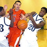 Elyria's Jarred Schultz and Lorain's Gerald Howard fight for the ball. LINDA MURPHY/CHRONICLE