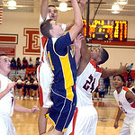 North Ridgeville's Chad Kisel goes for the shot against Elyria's Jarred Schltz, center, and AJ Johnson. LINDA MURPHY/CHRONICLE
