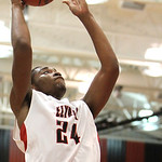 ANNA NORRIS/CHRONICLE Elyria's A.J. Johnson puts up a shot against Parma in the first half Friday night at Elyria High School.