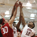 ANNA NORRIS/CHRONICLE Elyria's Anthony Duckett and Parma's Greg Smalley reach for the rebound in the first half Friday night at Elyria High School.