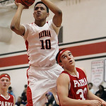 ANNA NORRIS/CHRONICLE Elyria's Isaiah Walton puts up a shot over Parma's Greg Smalley in the second quarter Friday night at Elyria High School.
