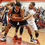 Valley Forge's Timothy Captain and Elyria's Trenell Oliver fight for a rebound. STEVE MANHEIM/CHRONICLE