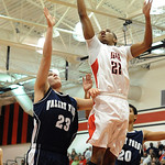 Elyria's Trenell Oliver puts in a shot over Valley Forge's Zachary Zevehik. STEVE MANHEIM/CHRONICLE