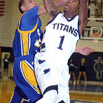 Lorain's Eddie Williamson shoots over Clearview's Daimon Knowles. LINDA MURPHY/CHRONICLE