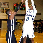 Lorain's Sherman Saunders shoots past cCeveland Heights' Jeremy Holmes. LINDA MURPHY/CHRONICLE