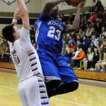 Midview's Daimion Mahone puts up a shot over Vermilion's Kyle Nader. STEVE MANHEIM/CHRONICLE