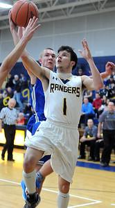 North Ridgeville's Jordan Montgomery drives to the basket past Midview's Logan Bolin. STEVE MANHEIM/CHRONICLE