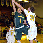 Amherst's Antonio Serrano shoots over North Ridgeville's Tyler Arnold. LINDA MURPHY/CHRONICLE