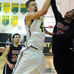 Oberlin's Charles Lewis blocks a shot by Amherst's Danny Fortney. STEVE MANHEIM/CHRONICLE
