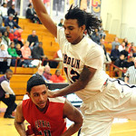 Elyria's Isaiah Walton is guarded by Oberlin's Charles Lewis. STEVE MANHEIM/CHRONICLE