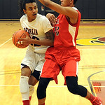 Oberlin's Charles Lewis is guarded by Elyria's Isaiah Walton. STEVE MANHEIM/CHRONICLE