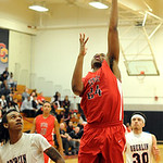 Elyria's AJ Johnson puts up a shot over Oberlin's Charles Lewis. STEVE MANHEIM/CHRONICLE