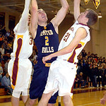 Olmsted Falls' Alex Mitchell tries to shoot past Avon Lake's Jace Russell, left, and Jason Hessel. LINDA MURPHY/CHRONICLE