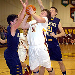 Avon Lake's Ben Oxley drives to the basket past Brian Kurz, left, and Kevin Meehan. LINDA MURPHY/CHRONICLE