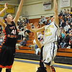 Olmsted Falls' James Sabatka shoots over North Olmsted's Andy Lucien. STEVE MANHEIM/CHRONICLE