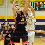 North Olmsted's Andy Lucien and Olmsted Falls' Kevin Meehan go for the rebound. STEVE MANHEIM/CHRONICLE