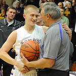 Vermilion's Cameron Kuhn shakes hands with former scoring leader John Halley. Kuhn broke Halley's 48-year-old record. STEVE MANHEIM/CHRONICLE