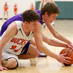 Vermilion's Aaron Dawson battles for a loose ball against Buckeye's Cory Inman during the second quarter of the Westlake district semi-final game. (RON SCHWANE / CT)