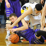 Vermilion's Seth Konrad, left, and Jeff Thomas of Norwalk reach for a loose ball in overtime. DAVID RICHARD / CHRONICLE