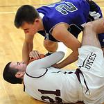 Keystone's Brandon Kuhl and Wellington's Matt Bullock fight for the ball. STEVE MANHEIM/CHRONICLE