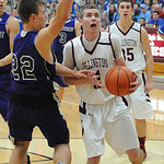 Wellington's Dylan Kidd drives past Keystone's Brandon Kuhl. STEVE MANHEIM/CHRONICLE