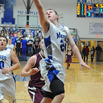 Midview'S Grant Overy goes for the layup. STEVE MANHEIM/CHRONICLE