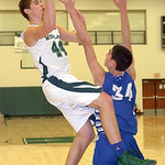 Westlake's Gavin Skelly drives past Bay's Rex Sunahara for a basket. LINDA MURPHY/CHRONICLE
