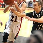 Brookside Josh Zenkert grabs a rebound from EC Cory Strasko Jan. 3.  Steve Manheim