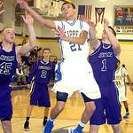 Clearview's #21 Daimon Knowles shoots past Keystones's #45 Adam Hopkins and #1 C.J. Conrad.