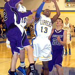 Clearview's #13 Clifton Brown tries to shoot past Keystone's #2 Collin Fitzgerald and #22 Brandon Kuhl.
