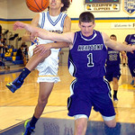 Clearview's #1 Gerrell Williams is fouled by Keystone's #1 C.J. Conrad as he leaps for the basket.