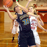 Clearview's #32 Raquel Santana fights Lutheran West's #40 Amanda Stephens for the rebound.